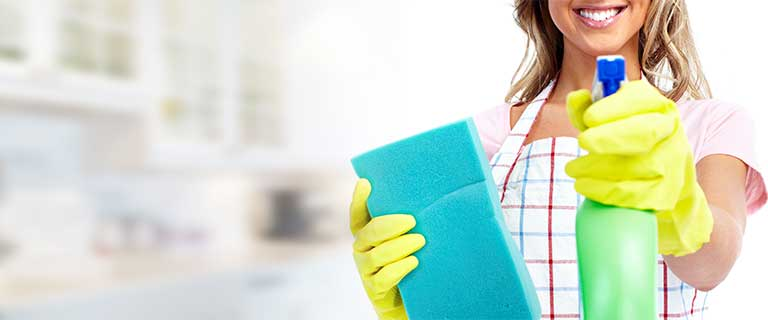 A woman prepared to do home cleaning